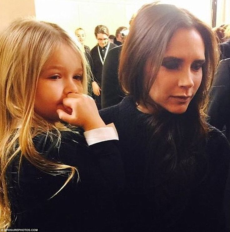 Well-behaved: Harper proved she's got the manners to sit front row during NYFW...
