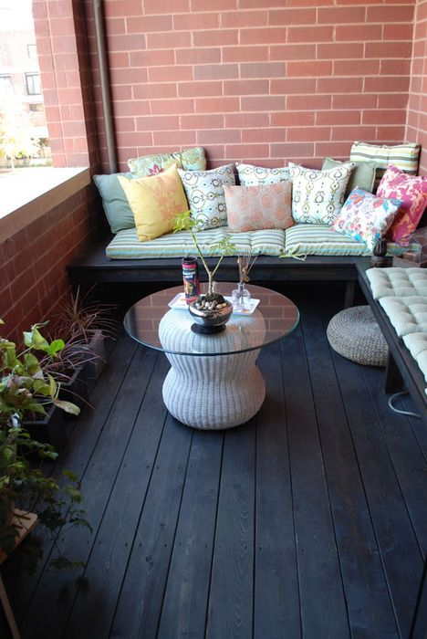 These benches add lots of seating without taking up much space.  Add lots of pillows and cushions and you've got a comfy place to relax on your apartment balcony.