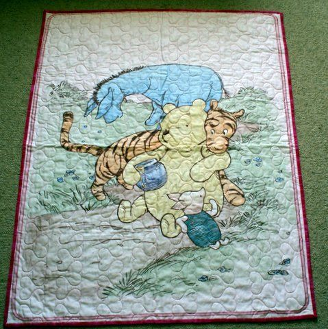 Australian Handmade Gifts - Winnie the Pooh Cot Quilt - $75 - https://www.highlandshandmade.com.au/winnie-the-pooh-cot-quilt-75-2/ - Winnie the Pooh Pink  The well known children's story with a pale backing.  100% cotton front and backing fabric with lightweight wadding.  Machine quilted with heart shapes. Washable with a gentle cycle.  Suitable for a little girl. Size 108 x 87 cms  Made in the Southern Highlands of country NSW by Dennis Buck.  Time taken to mak