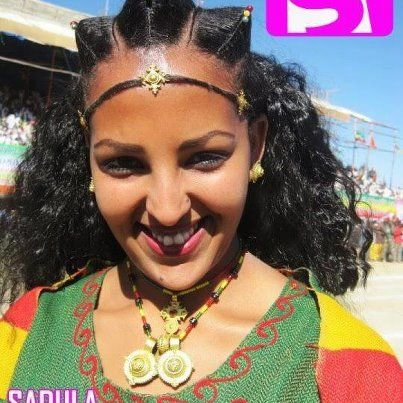 A typical Tigrai young lady wearing gold jewelry and hair style common in northern Ethiopia. The hair style and jewelry indicate that the young woman is married. Married, unmarried and widowed women ( who are done with men for the rest of their life) show their marital status by the hair style they wear in the Tigrai culture.