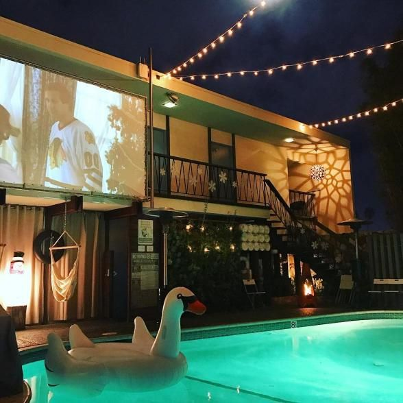 A modernist motel in San Diego, The Pearl showcases movies on a big projector by the pool. | Photo Credit: Jenn Johnson