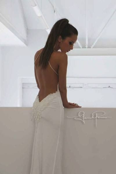 Backless sexy white wedding dress | Young fitting wedding dress. SO beautiful. I wouldn't get married in it but I ADORE it.