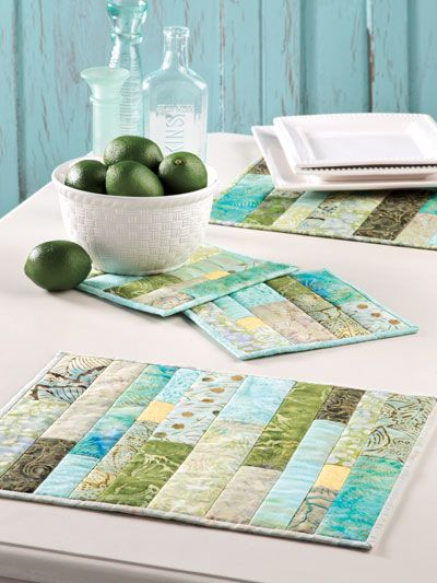 "Green Tea Place Mats & Hot Pads / - Quilting - Add a fresh, crisp look to your table with leftover strips to liven up a table setting with this colorful pieced set. Size: Place Mat: 15"" x 12"". Hot Pad: 7 1/2"" x 7 1/2"". Skill Level: Beginner"
