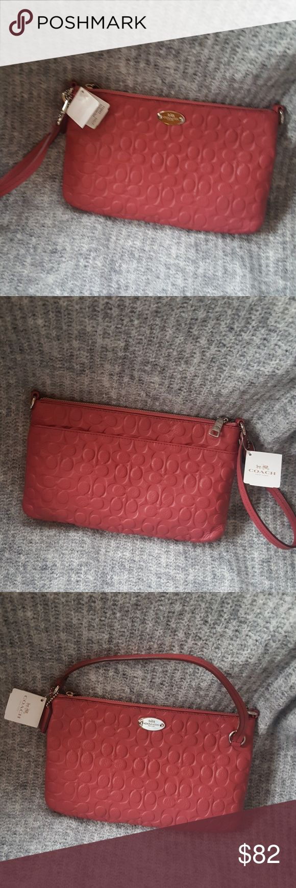 Coach clutch Sunset red Coach clutch.  Card pockets inside.  Pocket on back. Coach Bags Clutches & Wristlets