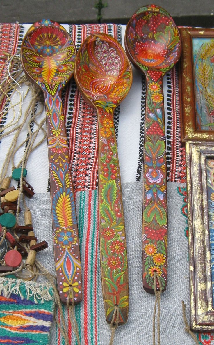 Though the scale might be hard to determine from the photo, the Russian wooden spoons pictured above are easily a foot long.  Hand painted, they are intended to be used and not merely hung as decorations