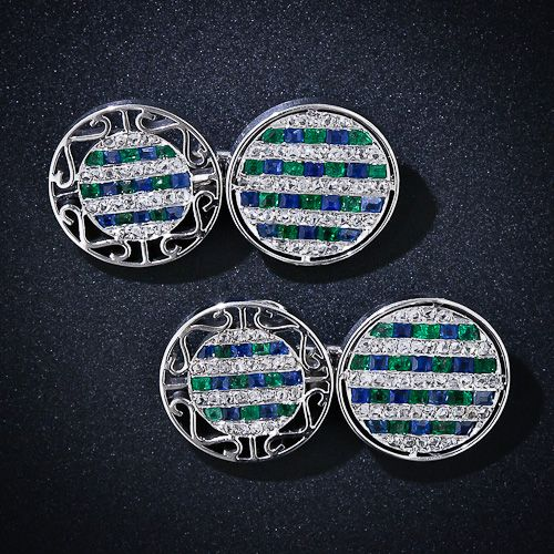 Supremely fine and fabulous original double-sided Art Deco cufflinks intricately crafted in platinum circles and set with alternating rows of tiny rose-cut diamonds and rows of alternating calibre emeralds and sapphires. Circa 1930. The best! Just over 1/2 inch in diameter.