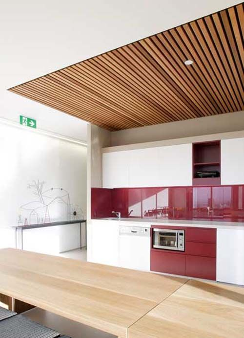 Adapt this slatted ceiling idea for above living area.