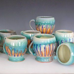 Stoneware pottery mugs (as seen on her blog) by a Maine potter who soda fires her work. A fun blog to read.