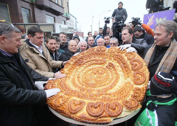 Christian Serb Orthodox believers breaking traditional Christmas bread 2011    Read more: http://www.businessinsider.com/pictures-orthodox-christmas-2011-1?op=1#ixzz1ine5acws