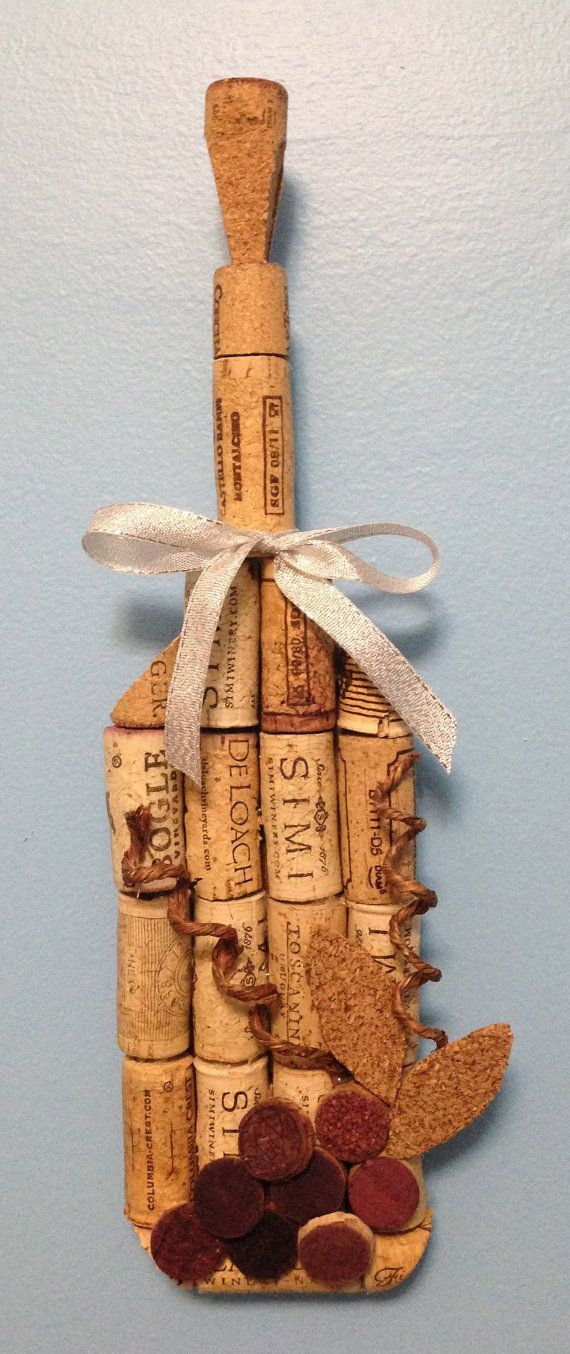 Items similar to wine bottle wall hanging made from recycled corks on Etsy