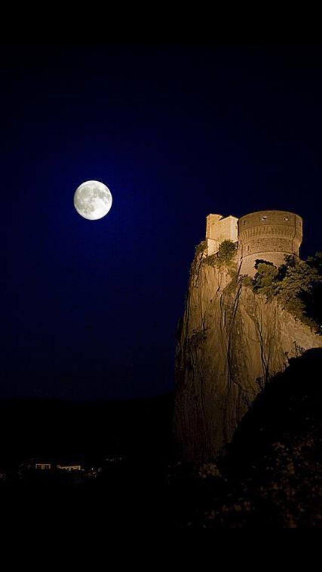 The Fortress Ruins of San Leo overlooks the valley of river Marecchia and a landscape of woods, rocky peaks and ravines which slopes to the sea, Rimini, Emilia-Romagna, Italy.