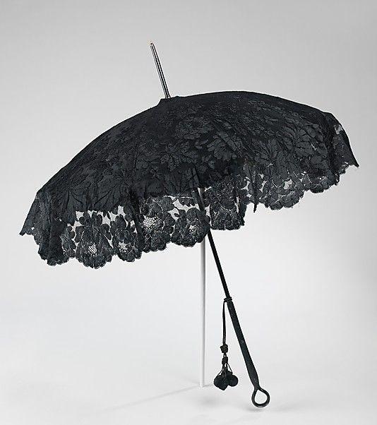 Parasol  G. Fox & Company (American, founded 1847)  Date: 1885–90 Culture: European Medium: silk, wood, metal Dimensions: 39 1/2 in. (100.3 cm)