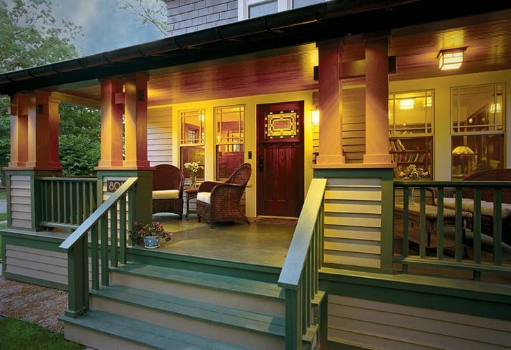 Beautiful deck. Carefully proportioned new railings and boxed column bases lend solidity and provide a sense of enclosure on the porch. Special accent lighting at night brings out the detailing and forms of the column assemblies.