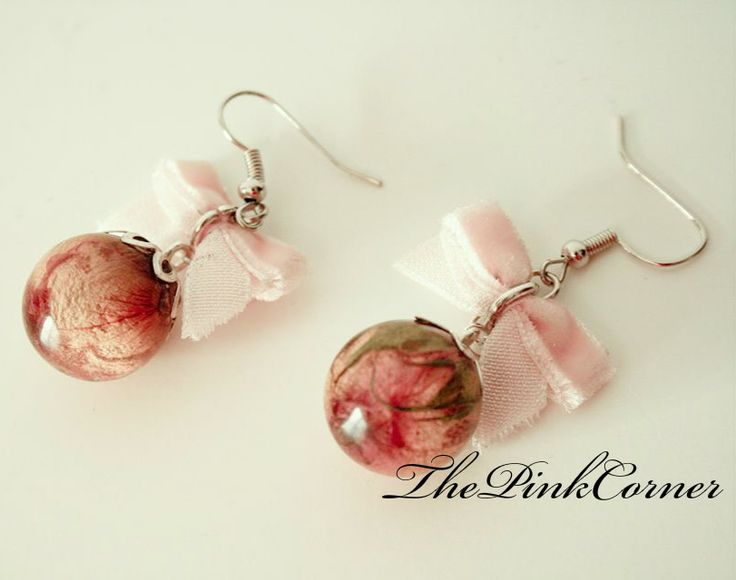 Crystal clear resin sphere earrings with pink rose buds https://www.facebook.com/media/set/?set=a.801464386550439.1073741840.181333861896831&type=1