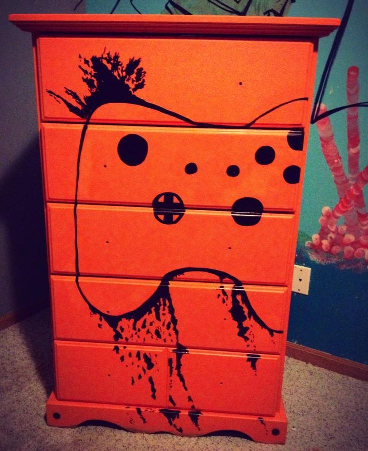 Unfinished dresser $20 meets left over paint and a magic marker. Xbox remote control dresser for my pre-teen's room.