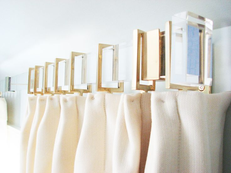 Lucite curtain rod with rectangular brass rings - Love!   Gretchen Everett Hardware and Home