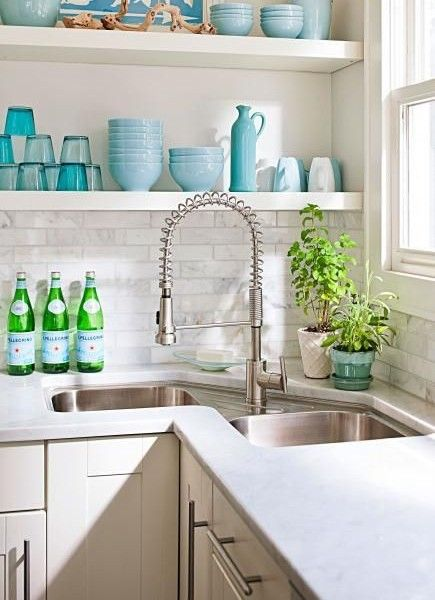 I like the idea of a corner sink. Not a fan of the faucet though.