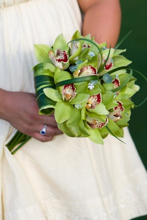 I love the stems and leaves! I would like the orchids to be more colorful and other flowers in the bouquet, too.  Bouquets | White Orchid Wedding