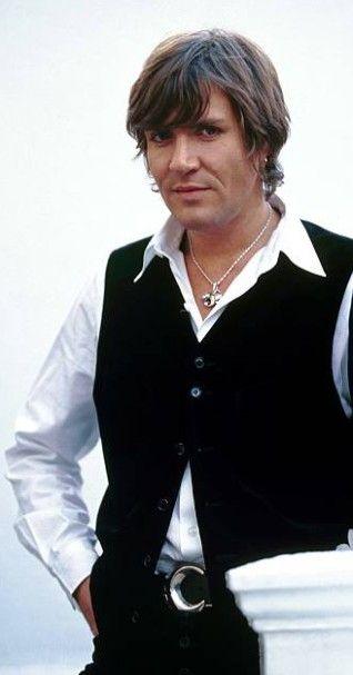 1993, black vest, tiger necklace