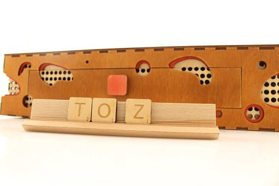 WOODEN SCRABBLE MIRO  The Scrabble is one of the most popular word games. We present you home made unique game, done with the extraordinary care for every detail. Our board is hand made of selected alder wood. We built the drawer in the board to let keep all the pieces safe. This allows you to store them in one place.  The set contains: wood board, 4 wooden scrabble tile racks and wooden letters. The game board measures approximately: 16,9 inch x 16,9 inch x 3,9 inch (430 mm x 430 mm x 100…