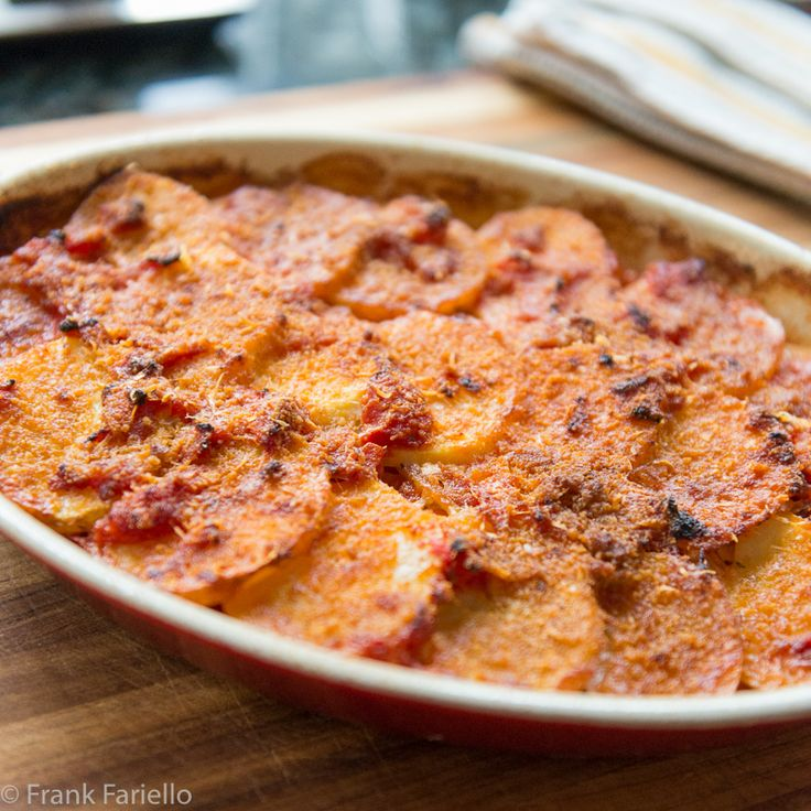 A crowd pleaser from the cuisine of Basilicata: patate alla lucana, potatoes layered with onions and tomatoes, scented with oregano and pecorino.