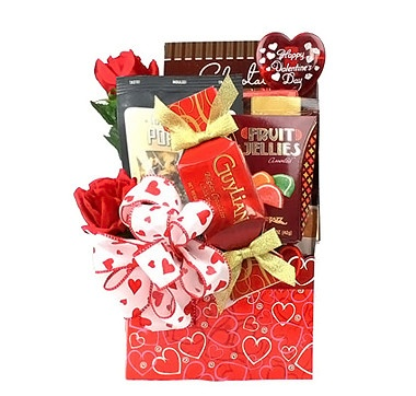 """Romance the one you love with this """"Be Mine"""" Valentine's Day Gift Basket and they may find themselves falling head over heels in love with this caring sentiment. Inside the red, heart-covered box is a selection of tasty treats and goodies that include Guylian chocolates, fruit jellies, Ghirardelli hot chocolate and a pair of beautiful silk roses. #ilovetoshop"""