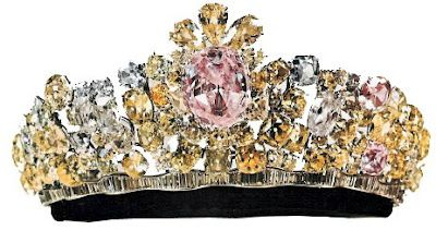 """The Noor-ol-Ain Tiara: Centerpiece """"Eye of Light"""" 60 ct. Pink Oval Diamond. Designed by Harry Winston, the tiara includes 324 total stones, a combination of pink, yellow, and white diamonds set in platinum. Most of them are over 14 carats. The whole piece is said to weigh over 4lbs."""