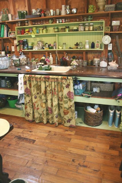 nancy's fabulous potting shed  (like the idea of vintage floral fabric to hide stuff in shelves-L)