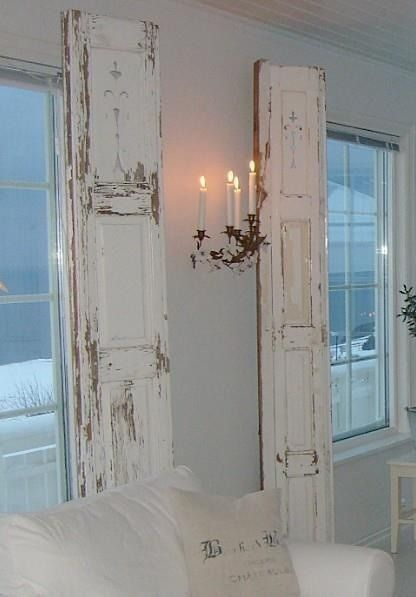 Old weathered shutters indoors and candlelight on a stormy night
