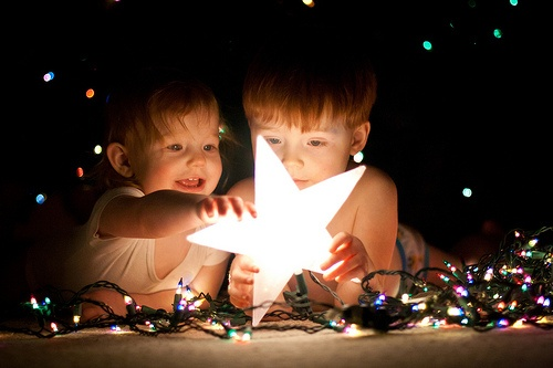 so cute, siblings, xmas lights, star. Good mood.