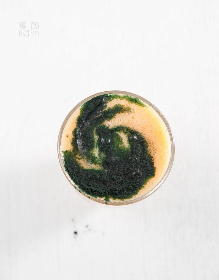 Green smoothie with papaya, pineapple, and spirulina