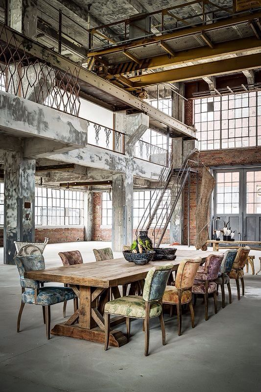 I'm so into the different colored chairs and the factory space. I wish the whole thing were furnished tho