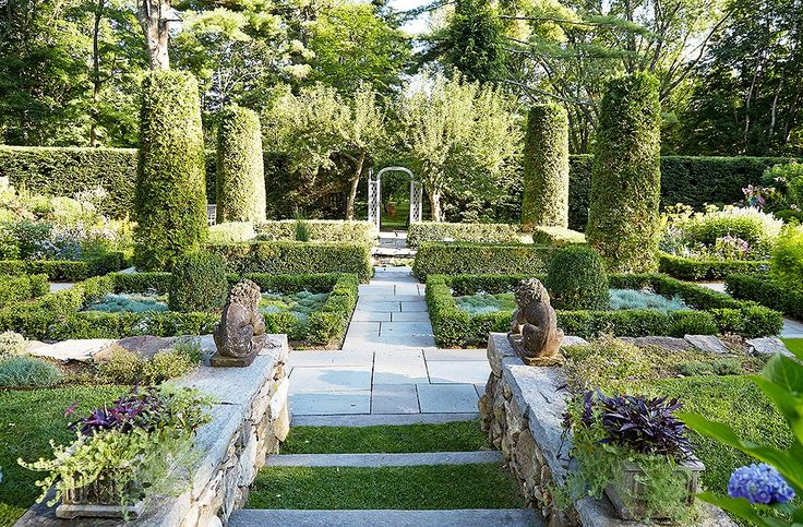 """""""This is the garden that John and I see from the porch,"""" says Bunnyof the sunken garden, which is anchored with a koi pond.""""I had a stone wall built to terrace the land. You have the sensation of moving from one space to another as you walk down the six big, wide steps that lead to the garden."""""""