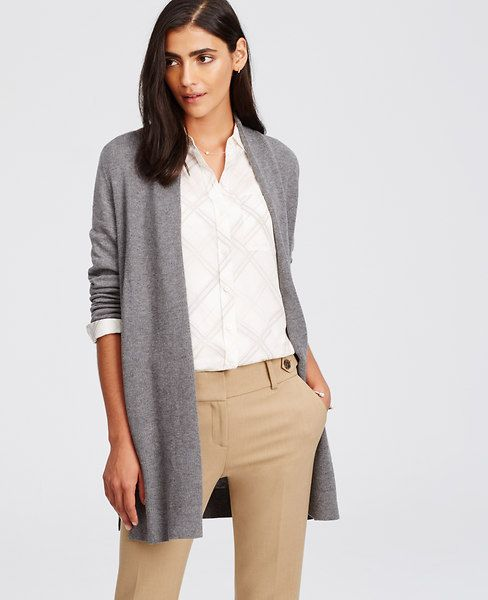 Covetably cozy, our wool-infused open cardigan is the essential layering piece for cool days and crisp nights. Open front. Long sleeves. Side slits. Ribbed cuffs and hem.