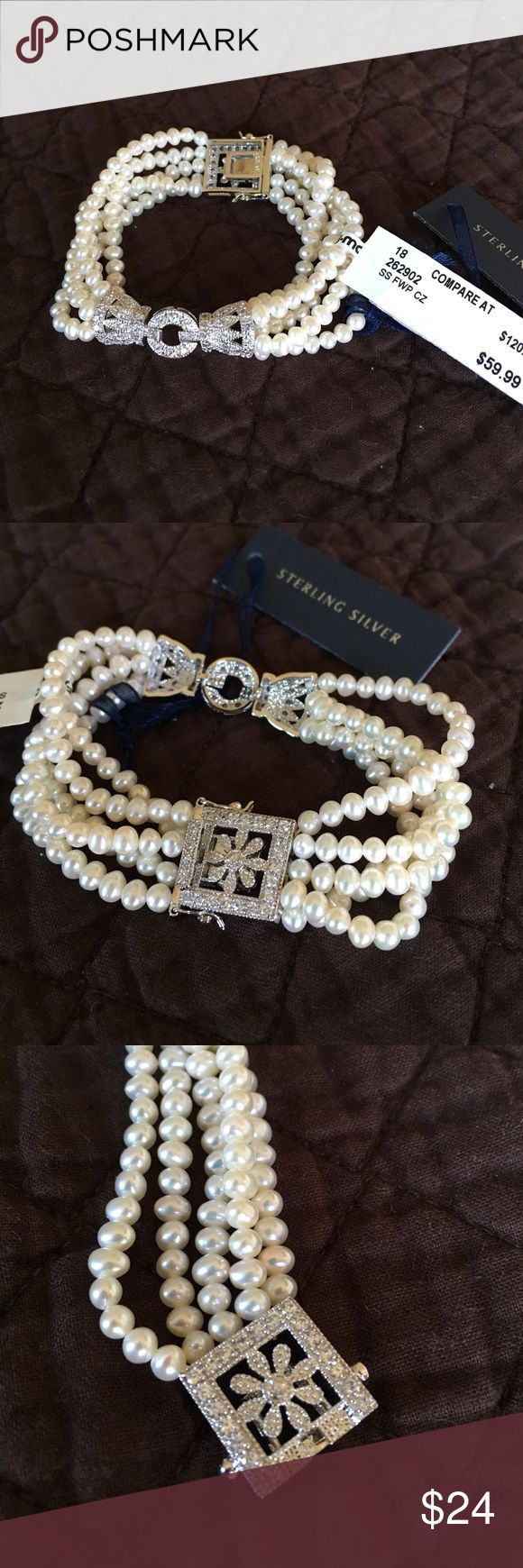 Sterling silver pearl bracelet NWT. Got at TJ Maxx to give as gift and never did. Rhinestones, fake pearls, but sterling silver. Locking clasp so can't get lost. Very elegant! I paid $47 on clearance. Contessa Di Capri Jewelry Bracelets