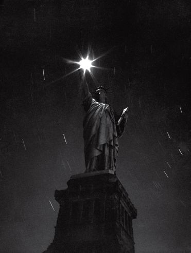 The Statue of Liberty, photographed during a blackout in 1942 — an eloquent expression of the nation's mood in the first full year of a glob...