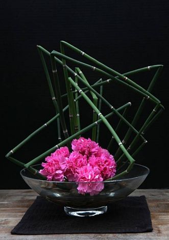 Imelda Iraeta from El Salvador used horsetail and carnations to create her ikebana floral arrangement at the Japanese Tea Garden in San Francisco, Calif., on Tuesday, March 8, 2011. Photo: Liz Hafalia, The Chronicle / SF
