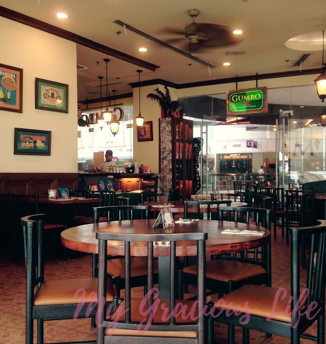 Gumbo restaurant serves New Orlean's Creole and Cajun food in a Mardi Gras like…