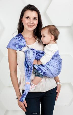 """Мамарада Слинг с кольцами Лаванда размер S  — 1834р. ----------- Слинг с кольцами позволяет носить ребенка как горизонтально в положении """"Колыбелька"""" так и в вертикальном положении. В слинге в положении """"Колыбелька"""" малыш распологается точно так же, как у мамы на руках, что особенно актуально для новорожденного. Ткань слинга равномерно поддерживает спинку малыша по всей длине. Малышу комфортно и спокойно рядом с мамой. Мама в это время может заняться полезными делами или прогуляться. В…"""