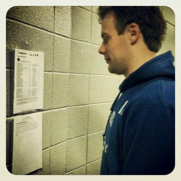 Ryan Hamilton checks out the rosters prior to the All-Star game.