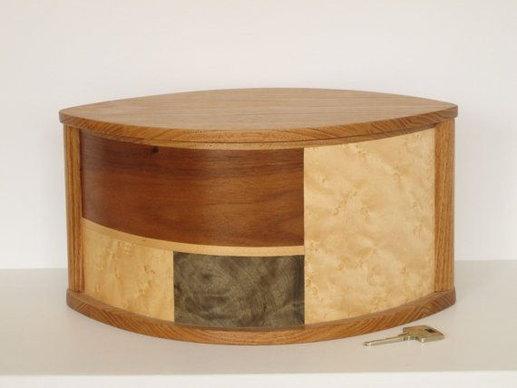 Simple and elegant wooden urn made of butternut and decorated with inlay