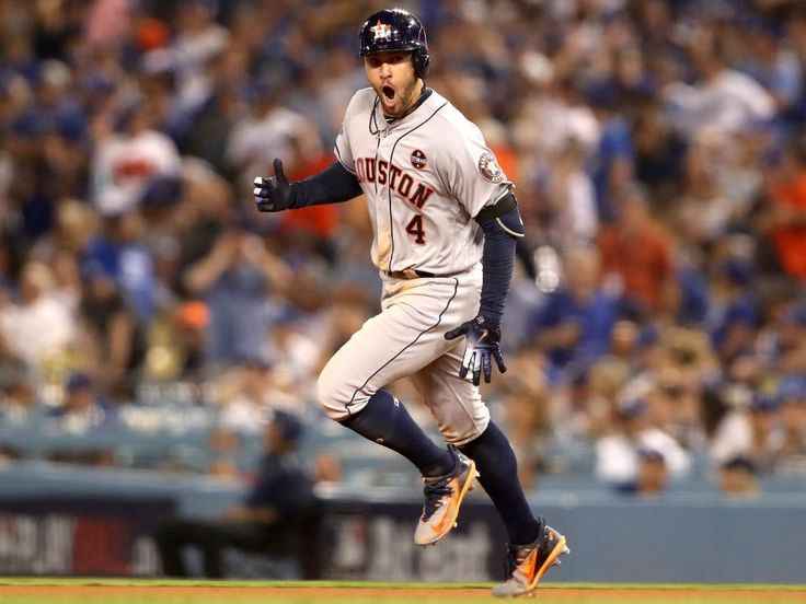 October 25, 2017:   Astros prevail over Dodgers in wild World Series Game 2.     George Springer #4 of the Houston Astros celebrates after hitting a two-run home run during the eleventh inning against the Los Angeles Dodgers in game two of the 2017 World Series at Dodger Stadium on October 25, 2017 in Los Angeles, California. (Photo by Christian Petersen/Getty Images)