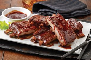 "SWEET 'n SPICY PORK BBQ RIBS RECIPE: ~ From: ""BBQ~Kraft Kitchens.com"". ~ Prep.Time: 15 min; Cook Time: 4 hrs, 0 min; Total Time: 4 hrs, 15 min; Yield: (4 servings). ~ Not a rib will be spared when you mix up our brown sugar and honey sauce, with just a dash of red pepper. Sweet, spicy, and as with all good BBQ, sticky."