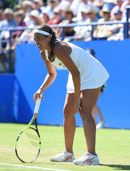 Monica Puig Photos - Monica Puig of Puerto Rico looks dejected in her match against Dominika Cibulkova of Slovakia on day six of the WTA Aegon International at Devonshire Park on June 24, 2016 in Eastbourne, England. - Aegon International - Day Six