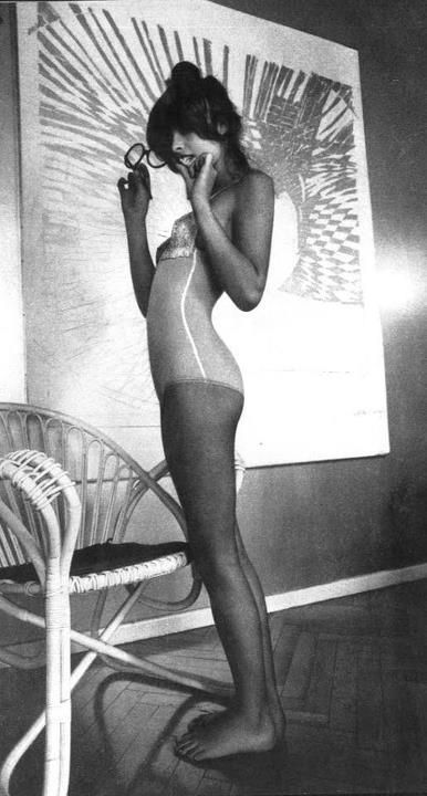 uschi obermaier barefoot in topknot and leotard, looking a bit underage.