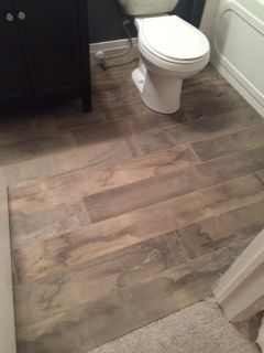 This water marked tile plank is super cool in this small space!