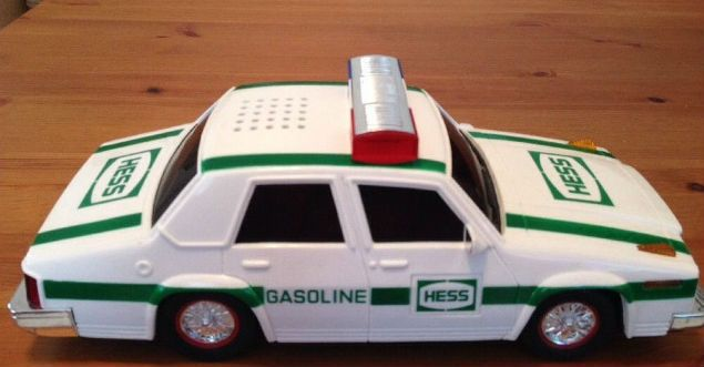 Vintage 1993 Hess Patrol Car  Breaking another first in the Hess toy fleet the 1993 Hess is a police car! That's right a Hess Patrol Car to be exact. This Hess law enforcement vehicle sports eight illuminated Hess logos plus flashing red, blue, and yellow emergency lights that can be synchronized with two realistic siren sounds. This toy broke all the Hess toy sales records and sold out before Christmas that year. And the fan excitement for this toy spilled over into a national news story.