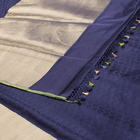 "The ""#Navy #Blue"" #handwoven #Banarasi #Satin #Silk #Sari from Shivangi Kasliwal is woven with floral bhutas all over the body that is set off by a gold zari banarasi border and pallu. The border is repeated on the green blouse with paisley motifs."