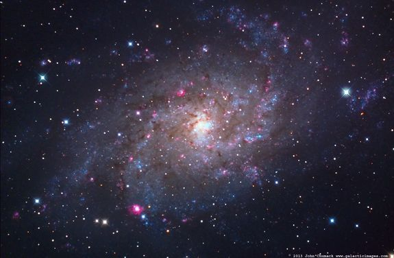Astrophotographer John Chumack took this image of The Pinwheel Galaxy, also called the Triangulum Galaxy or M33, after 4.3 hours of exposure... Credit  John Chumack