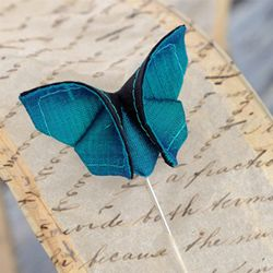 Oragami Butterfly? lol there's a tutorial but I failed at it xD You guys try your luck!